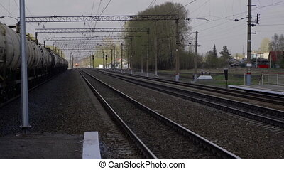 Suburban train arriving at the station, suburb of...