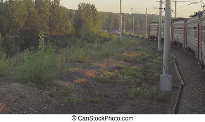 Suburban train at sunset