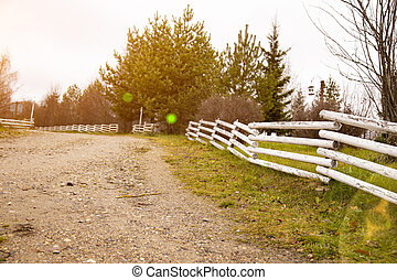 suburban wooden fence along the country road