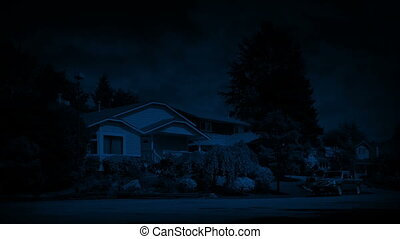 Suburbs At Night - Residential area with houuses and gardens...