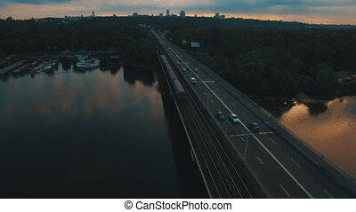 Subway and cars bridge.Cityscape on dusk aerial drone footage