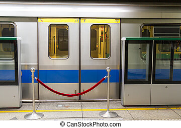 Subway coach with red rope barrier