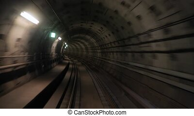 Subway journey view in dark tunnel