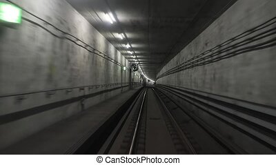 Subway journey view in dark tunnel