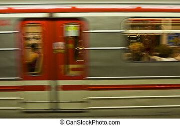 Subway - motion blur of a red and white subway train