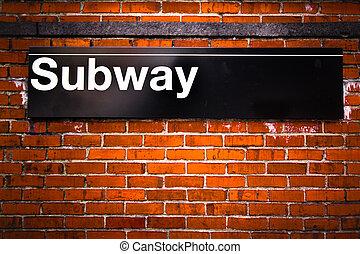 Subway - New York City subway sign entrance on brick wall