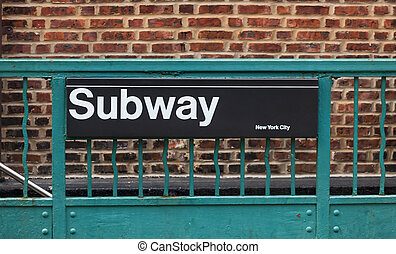 Subway sign in New York City with bricks wall on background