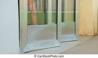 Subway station entrance doors - People pass through the...