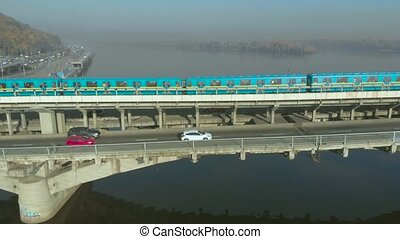 Subway train moving across a Bridge Metro, Kiev - Aerial...