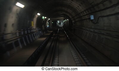 Subway train moving in tunnel and arriving to the station