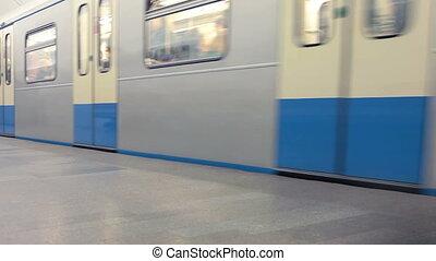 Subway train passes through station