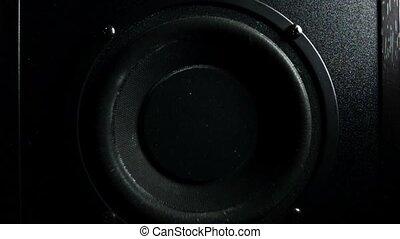 Subwoofer bass loud speaker in action. Super slow motion low key shot
