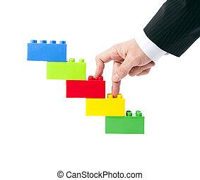 succes, symbool, zakenman's, hand, speelgoed, bouwsector
