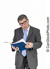 succesfsul business man with blue tie reading in a journal