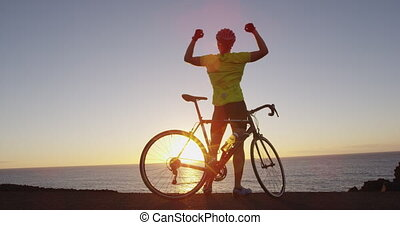 Success, achievement and accomplishment - man cycling ...