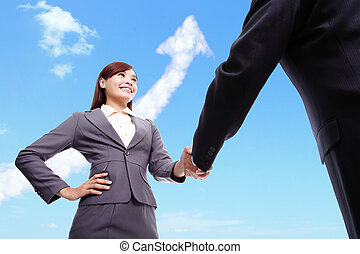 Success Business concept - woman and man handshake