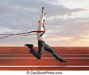 success - businessman wins the foot race