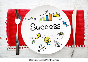 Success concept on white plate with fork and knife