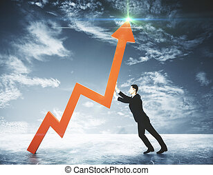 Success concept - Side view of young businessman pushing red...