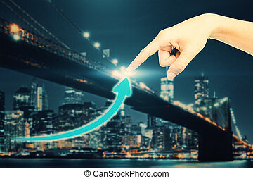 Success concept - Hand pointing at creative upward arrow on...