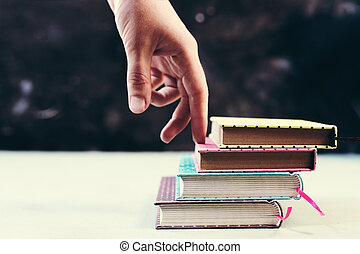 Success concept with fingers climbing stairs made of books stack