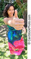Success gesture - Young lady with her thumb up indicating...