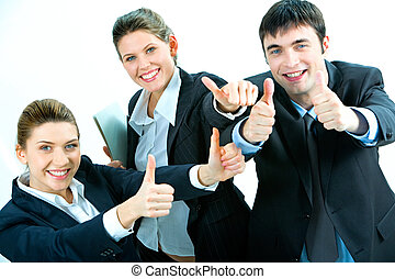 Image of business people giving the thumbs-up sign