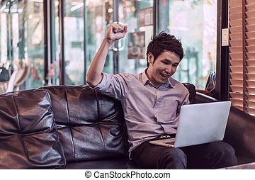 success man using laptop computer in cafe
