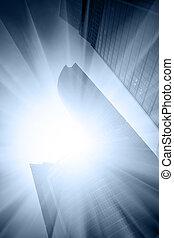 Modern skyscrapers close up and sun glare