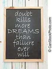 Motivational saying handwritten on a blackboard