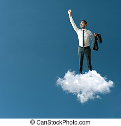 Success of a businessman over a cloud