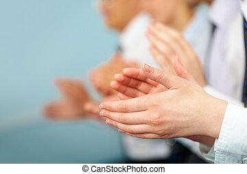 Success - Photo of business partners hands applauding at ...