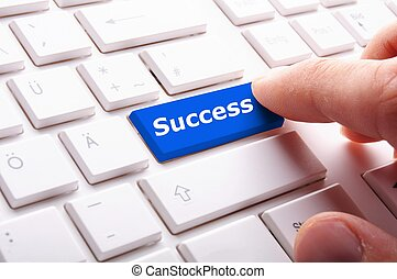 success in business concept with key on computer keyboard