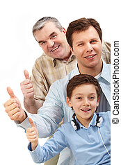 Success - Portrait of a father, grandfather and son showing...