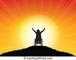 Success - Silhouette of a woman in a wheelchair with her...