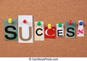 The word Success in cut out magazine letters pinned to a corkboard.