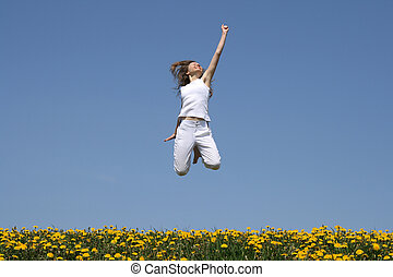 Success! Smiling young woman in a happy jump.