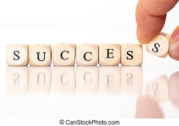 Success, spelled with dice letters