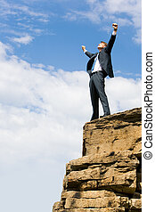 Success - Image of delighted businessman standing on the...