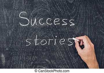 Success stories written on the blackboard using chalk