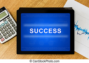 success word on digital tablet