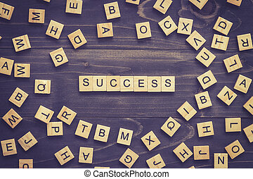 Success word on wood table for business concept.