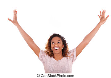 Successful african american woman with arms up expressing her jo