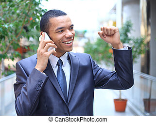 Successful african business man talking on the phone