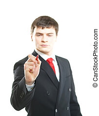 Successful and smart businessman writing imaginary text isolated on white background. Man is blurry, focus on the pen.