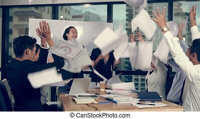 Successful Asian business people celebrate project success ...