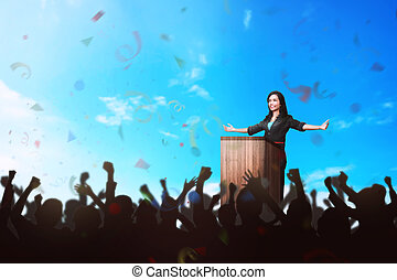 Successful asian business woman giving a speech in front of the people