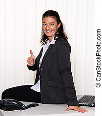 Young, successful businesswoman in the office