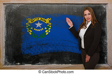 Successful, beautiful and confident woman showing flag of nevada on blackboard for marketing research, presentation and tourist advertising