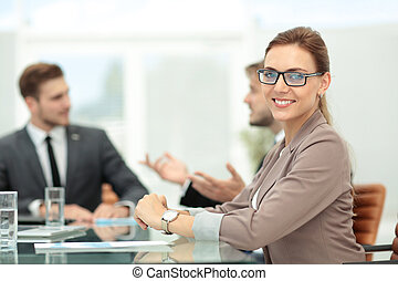 Successful beautiful business woman working with her staff -...